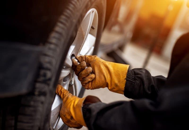 Mechanic installing new tires